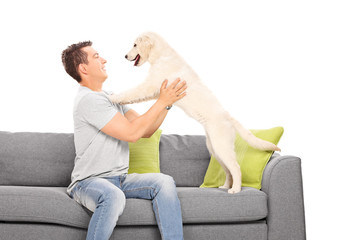Young guy playing with his dog