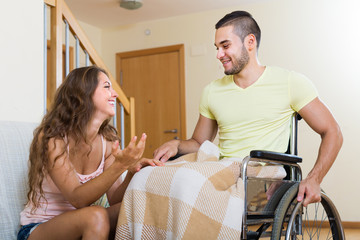 man in wheelchair and girl  having conversation