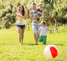 Parents with two kids outdoors