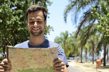 Male tourist with map
