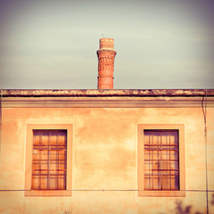 Old factory with smokestack - toned image