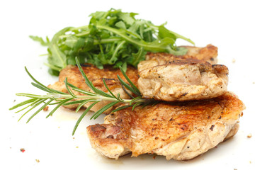 Grilled chicken steak with crispy skin and simple salad.