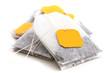 Leinwandbild Motiv Tagged teabags with string on white surface.