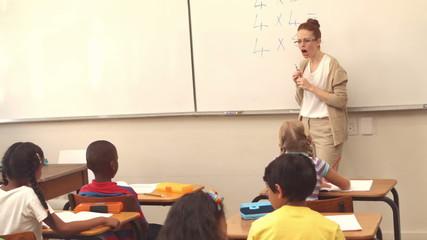 Pupils listening to their teacher at chalkboard
