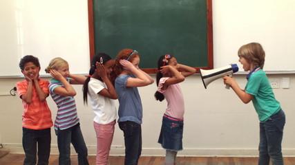 Pupil shouting at his classmates through megaphone