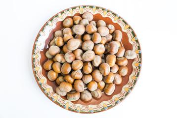 Unpeeled hazelnuts plate