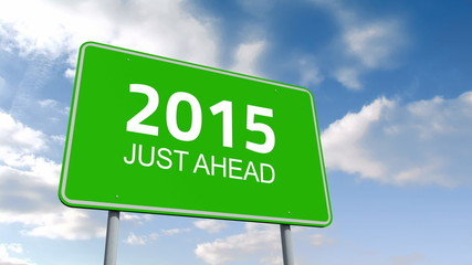 2015 and just ahead road sign over cloudy sky
