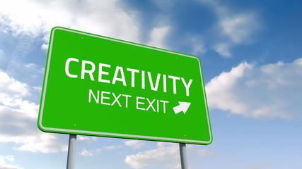 Creativity and next exit road sign over cloudy sky