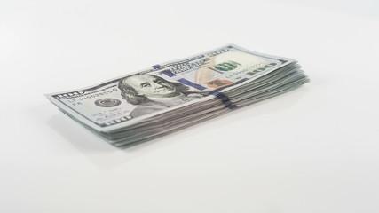 Stack of new 100 US dollar 2013 edition banknotes rotating bills