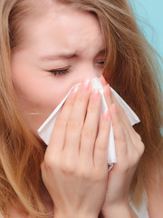 Flu allergy. Sick girl sneezing in tissue. Health