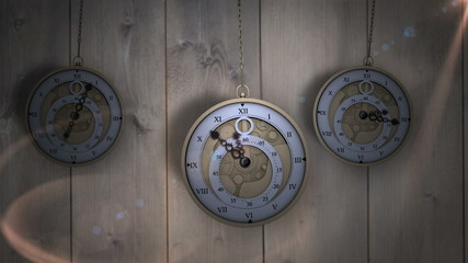 Hanging pocket watches ticking against wood