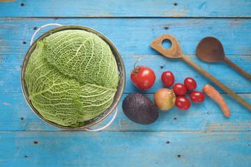 food ingredients, vegetables, wooden spoons, cooking concept