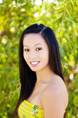 Smiling Outdoor Portrait Of Asian American Woman