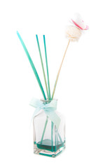 fragrance diffuser with paper butterfly over white background
