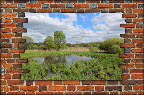 Leinwandbild Motiv broken brick wall and view to spring
