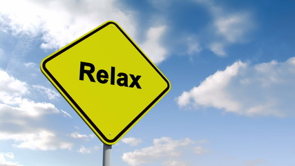 Relax sign against blue sky
