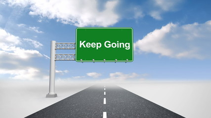 Keep going sign over open road