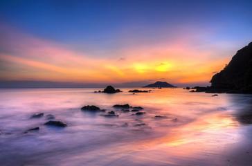 Sky island and sea at sunset.
