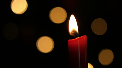Candle burning at christmas time