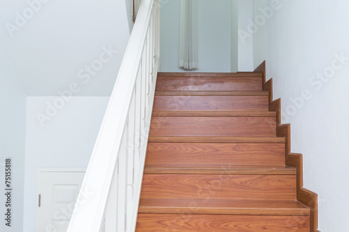 Papiers peints Escalier wooden staircase made from laminate wood in white modern house