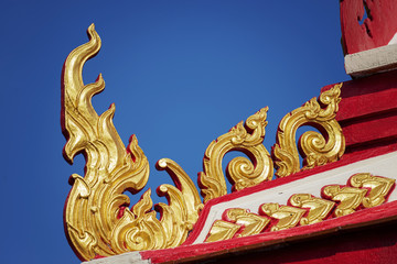 thai temple roof with blue sky