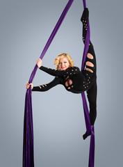 Beautiful dancer on aerial silk, aerial contortion