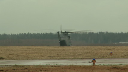 Military helicopter flies through runway