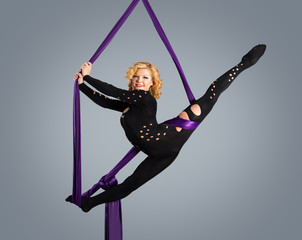 Beautiful dancer on aerial silk, aerial contortion