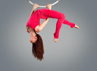 Plastic beautiful girl gymnast on acrobatic circus ring