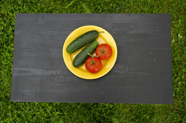 cucumber and tomato vegetable in yellow plate