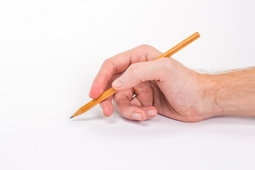 isolated male hand writing with a pencil