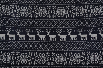 winter knitted pattern with deer and snowflakes