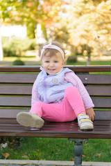 Smiling Girl on Bench