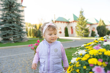 Girl Looking at Flowerbed