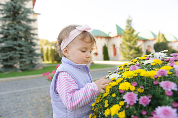 Girl Looking at Flower