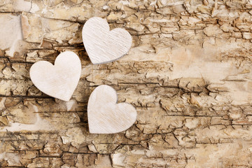 Wooden heart on bark background. Symbol of love