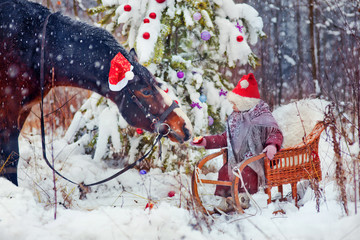 Little girl with horse at christmas eve