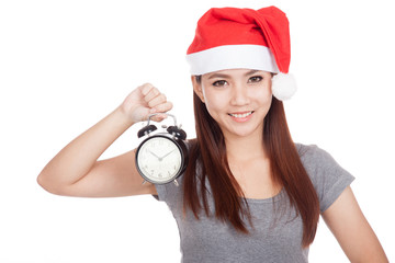 Asian girl with red santa hat and alarm clock