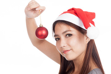 Asian girl with red santa hat hold bauble and smile