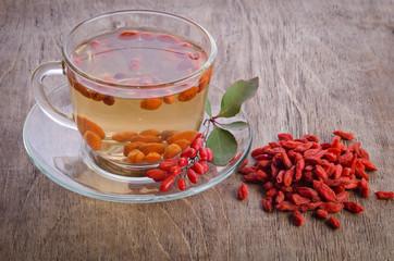 goji fresh antioxidant tea on wooden background