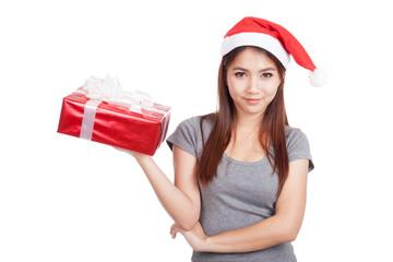 Asian girl with santa hat hold gift box