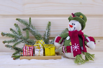 Toy Snowman among fir trees and presents