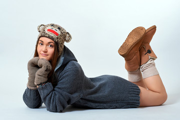 Young female in sweater, gloves and boots