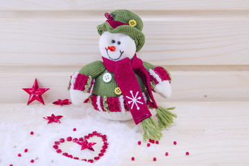 Snowman surounded by stars and hearts