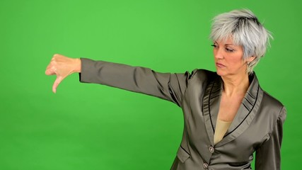 business woman shows thumb on disagreement - green screen