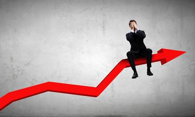 Businessman sitting on graph
