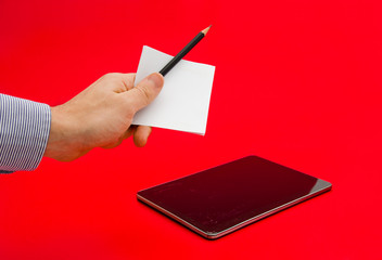 Paper notes and a pencil in comparisson with a modern tablet