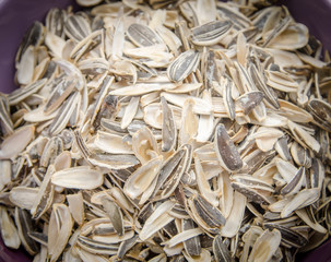 Sunflower seeds husk in a pile in a bowl