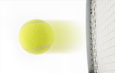 Fast speeding tennis ball being hit by a raquet