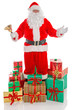 Father Christmas surrounded by presents, isolated on white.